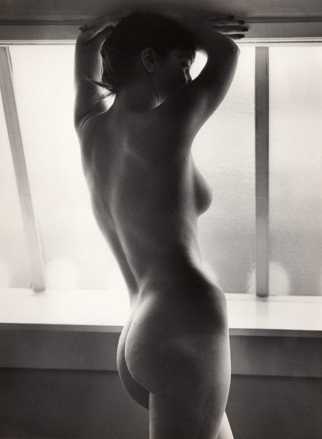 Untitled (Nude standing in the window)
