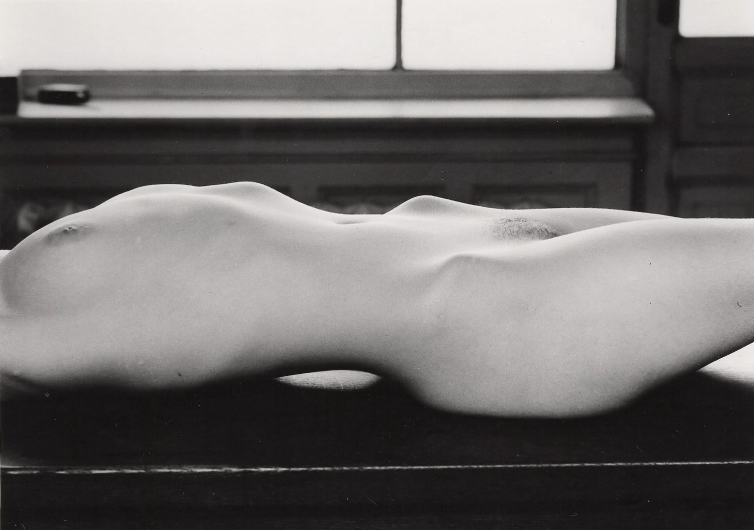 Untitled (Nude laying on bench)