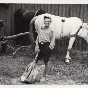 Vladu with a bag with grain which he will put on the horse neck, Romania