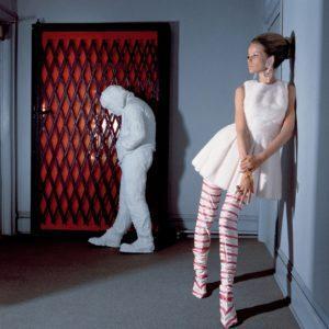"Veruschka in White Tennis Dress with George Segal's ""Walking Man"""