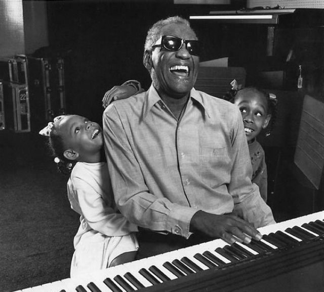 Singer Ray Charles with granddaughters in his home studio, LA