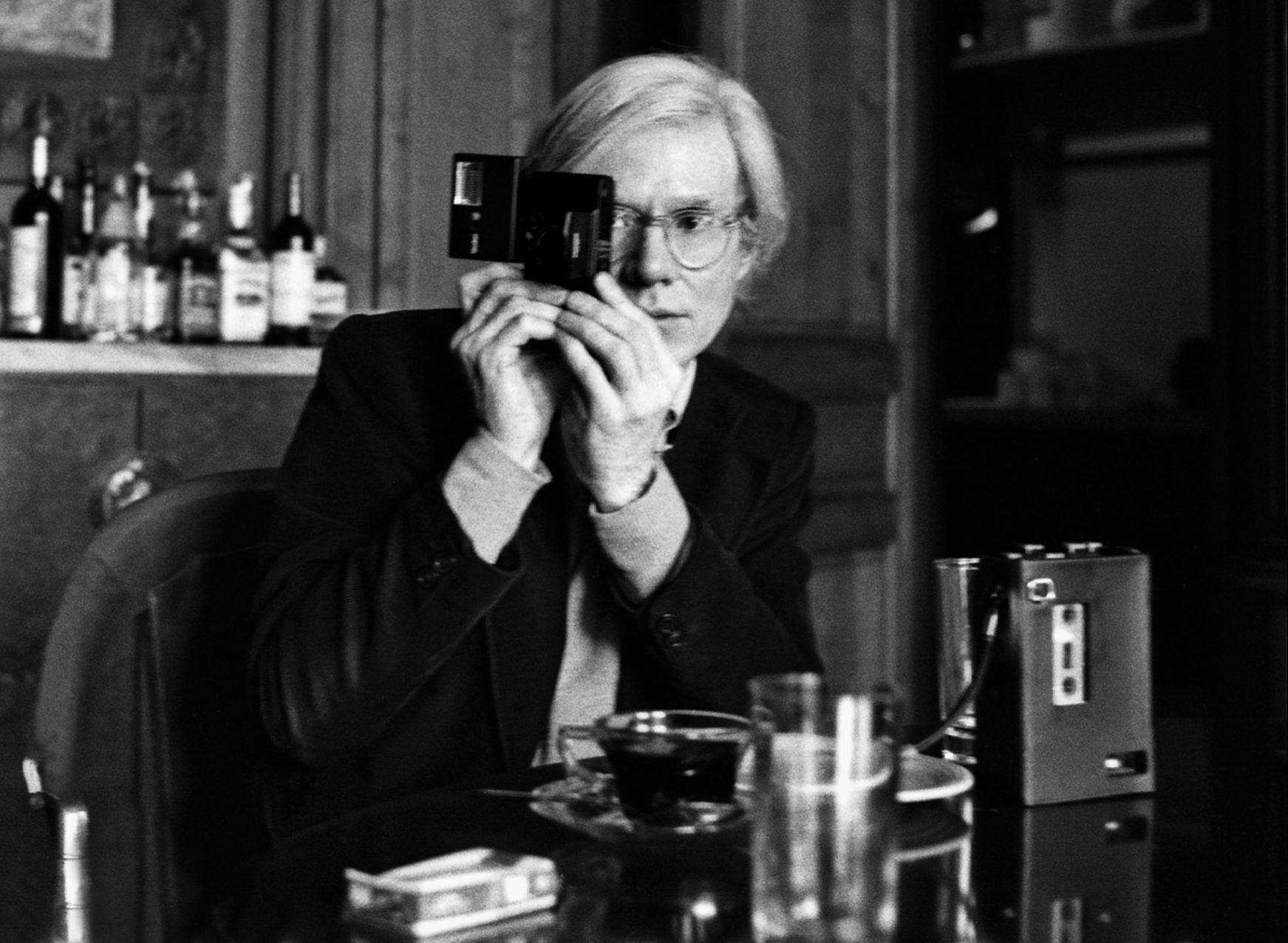 Andy Warhol with camera at The Factory, NYC