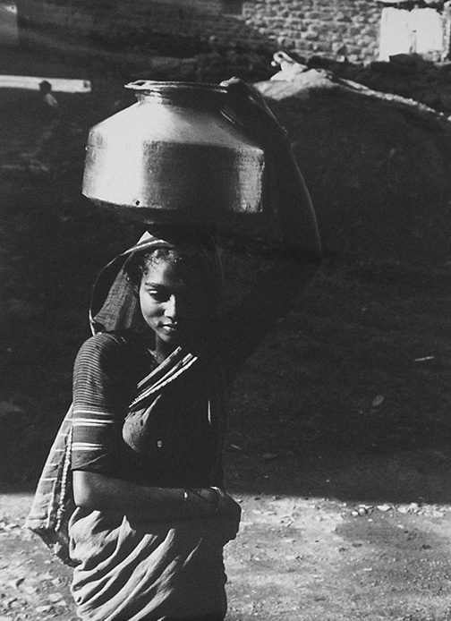 Indian Hindu woman carrying pot