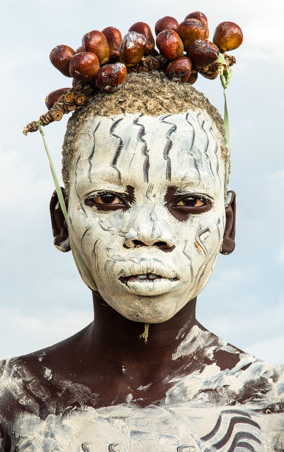 Kara Boy with Chalk Make up and Berry Adornment, Omo River, Ethiopia