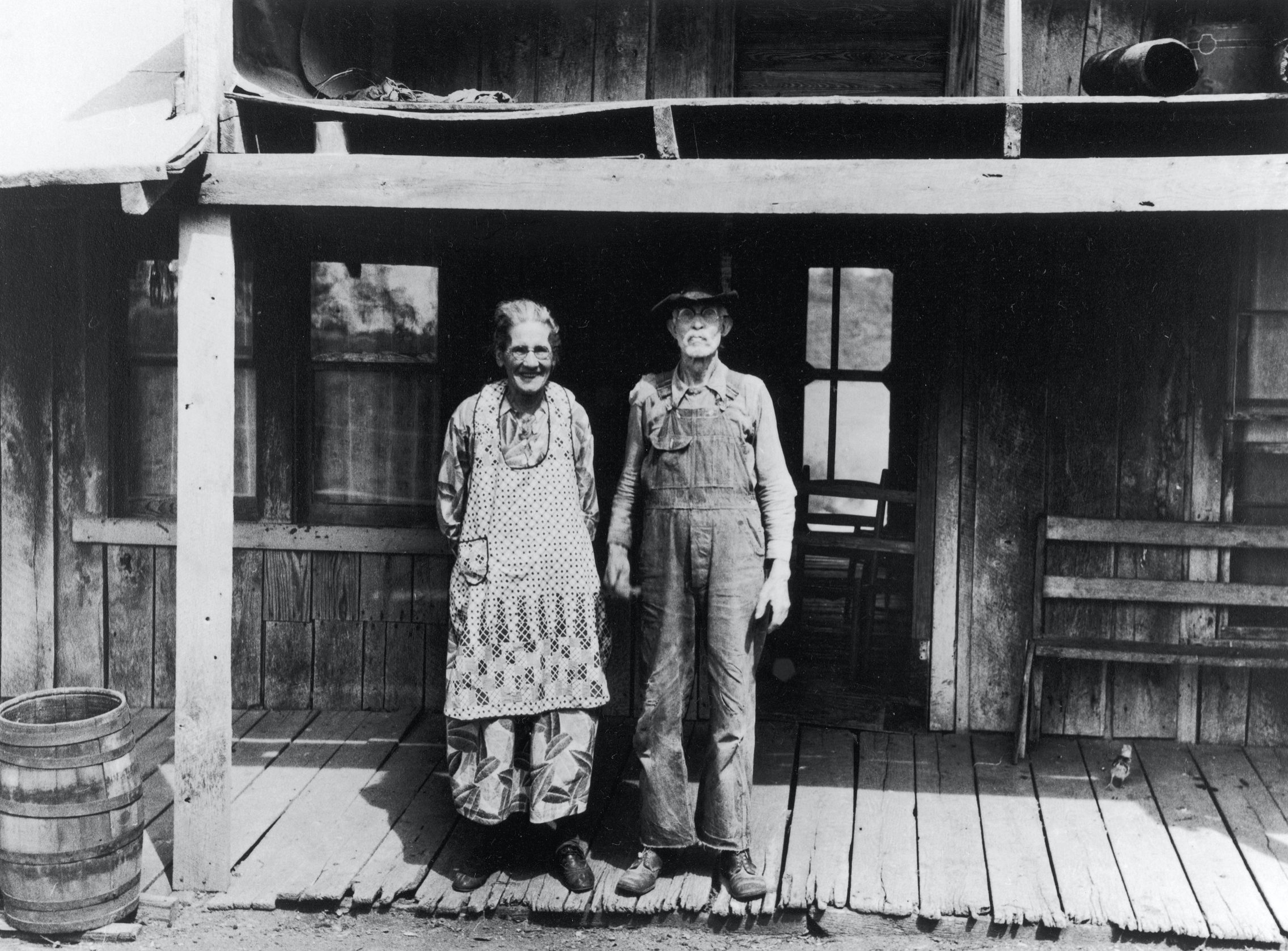 Sharecroppers standing on porch of shack