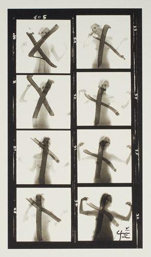 Marilyn Monroe behind crucifix, contact sheet with eight images, from The Last Sitting for Vogue
