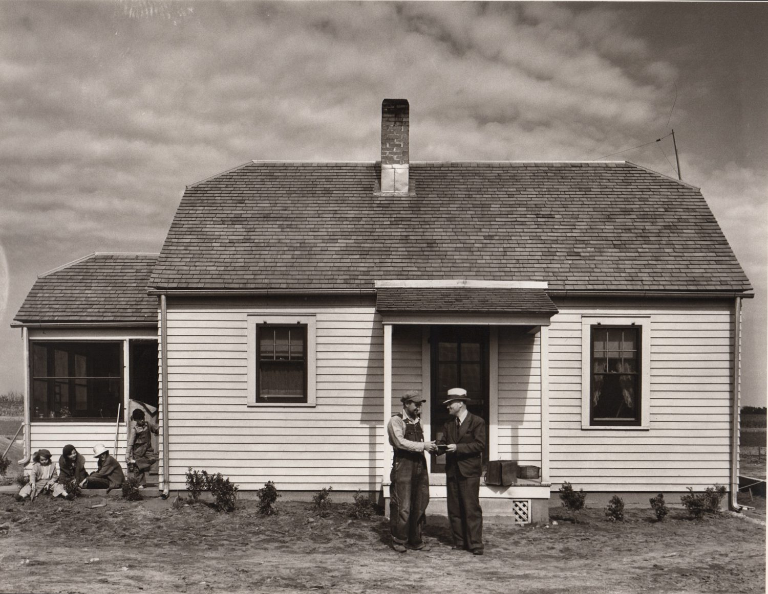 Federal Resettlement official with farmer at his new house. Fall City Farmstead, Nebraska