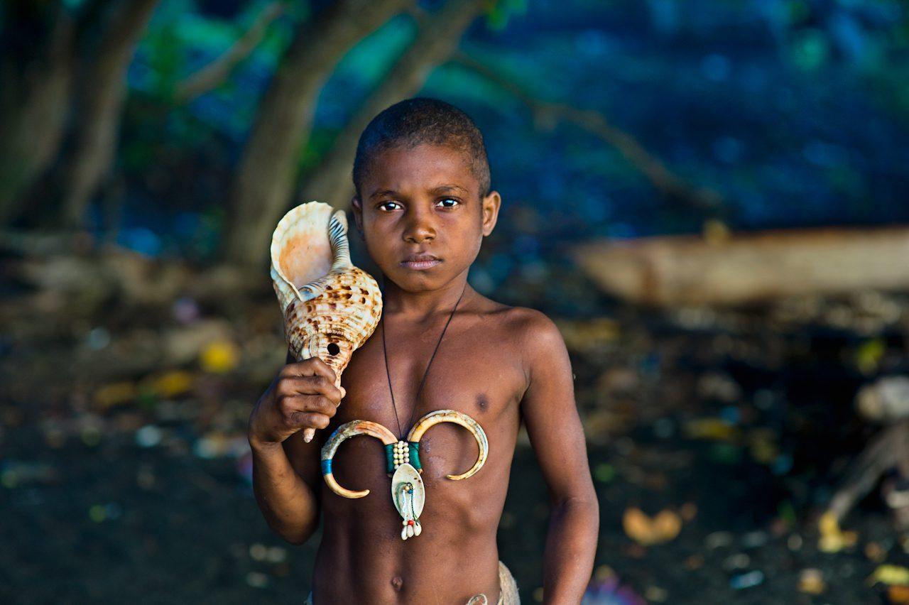 Tongyi Holding a Conch Shell, Sepik River, Papua New Guinea