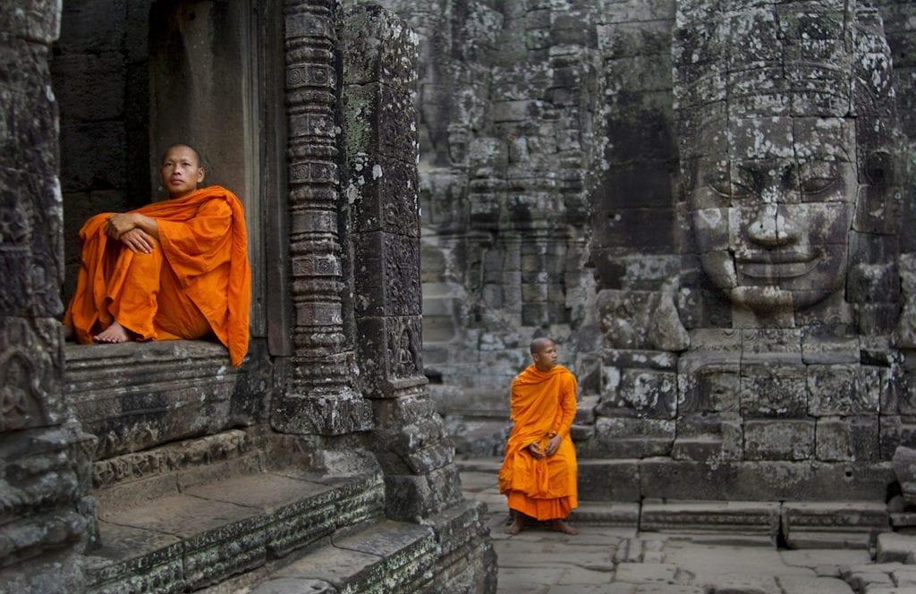 Monks Resting at Bayon Temple Angkor, Cambodia