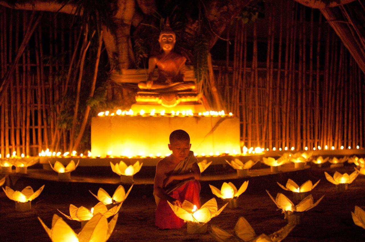 Monk Lighting Lotus Flower Lanterns for Loi Krathong, Chiang Mai, Thailand