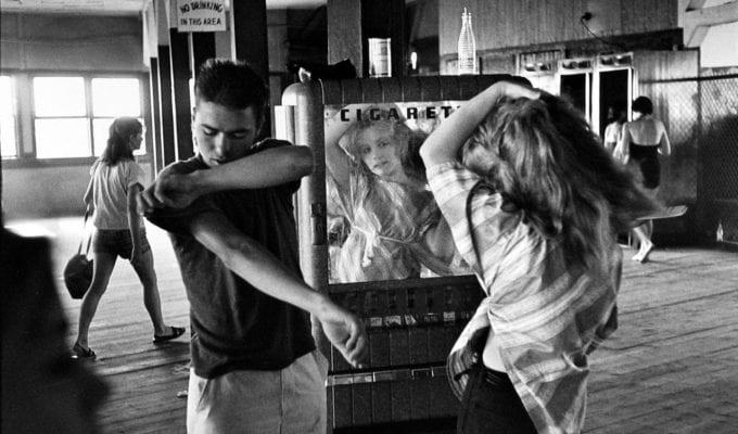 Bruce Davidson, Brooklyn Gang (Girl Combing Hair in Mirror at Coney Island Bath House)