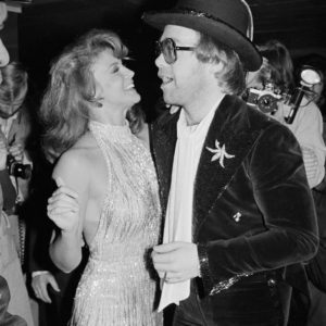"Robin Platzer Ann-Margaret with Elton John at the ""Tommy"" movie premiere"