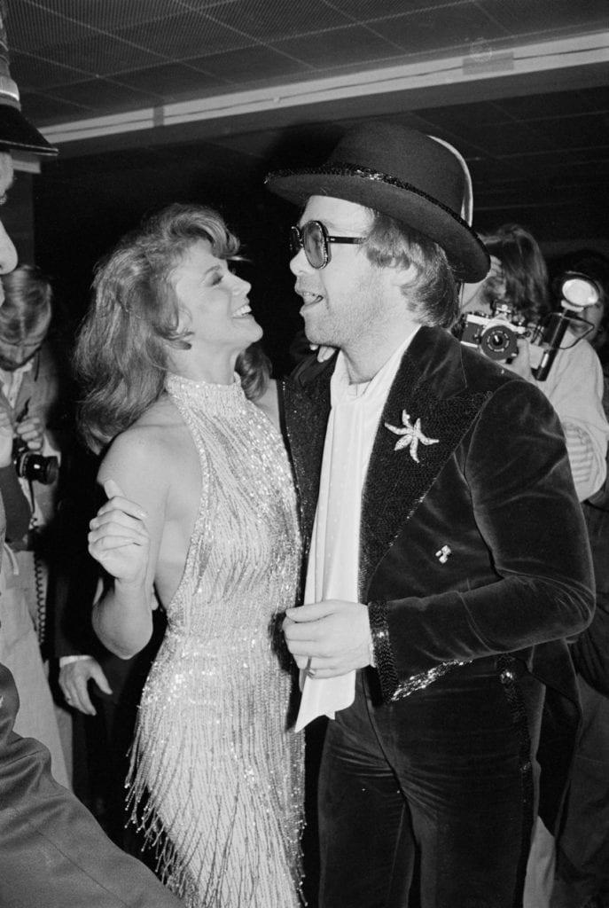 "Robin Platzer, Ann-Margaret with Elton John at the ""Tommy"" movie premiere"