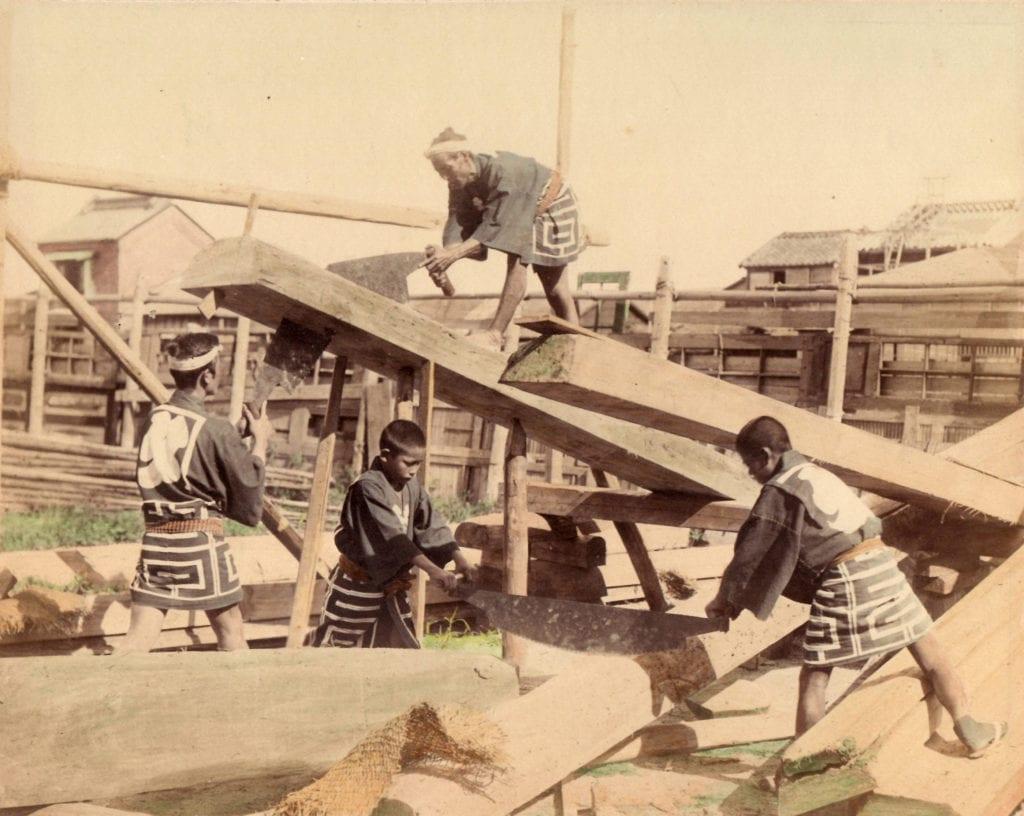 Studio of Felice Beato, Men and Boys Sawing Wood