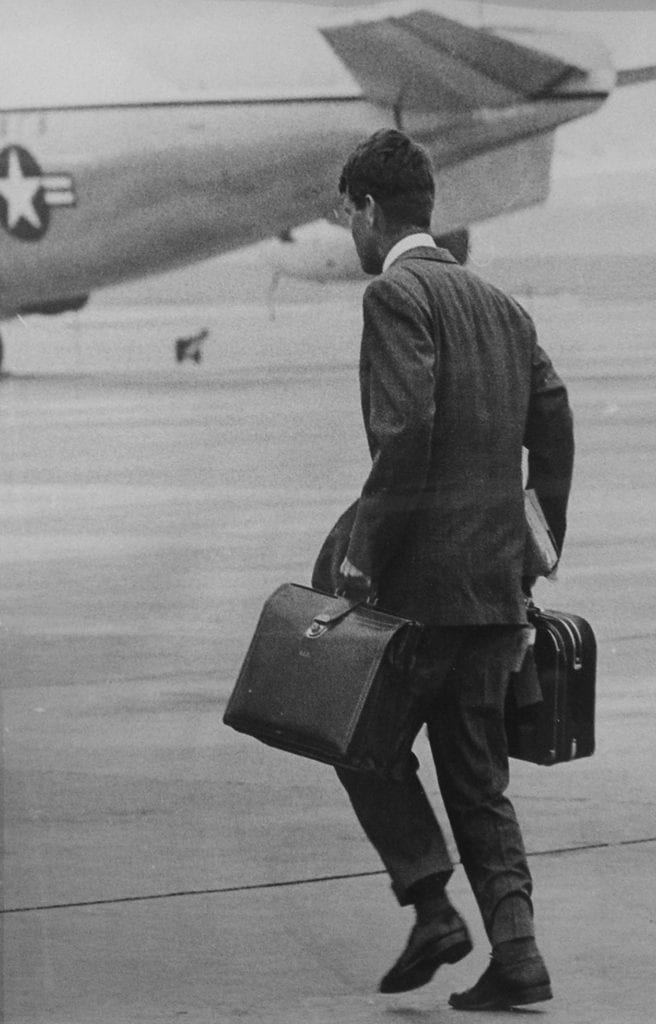 Stan Stearns, Robert F. Kennedy strides to Air Force One to join President Kennedy on a flight to Cape Cod