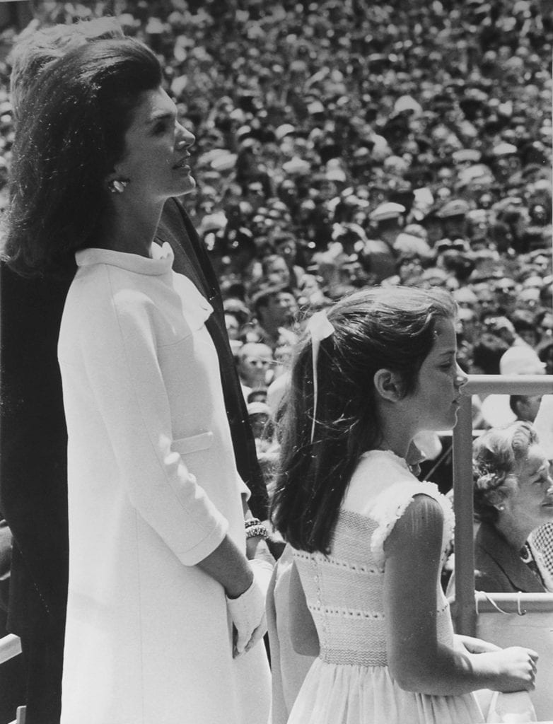 Stan Stearns, Jacqueline Kennedy and daughter Caroline admire the carrier John F. Kennedy after its christening by Caroline