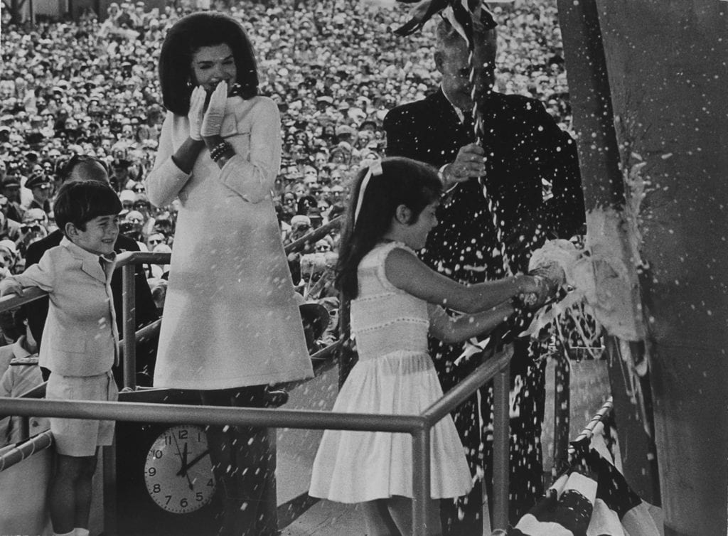 Stan Stearns, Caroline Kennedy christens the carrier John F. Kennedy as Jacqueline and John Jr. look on