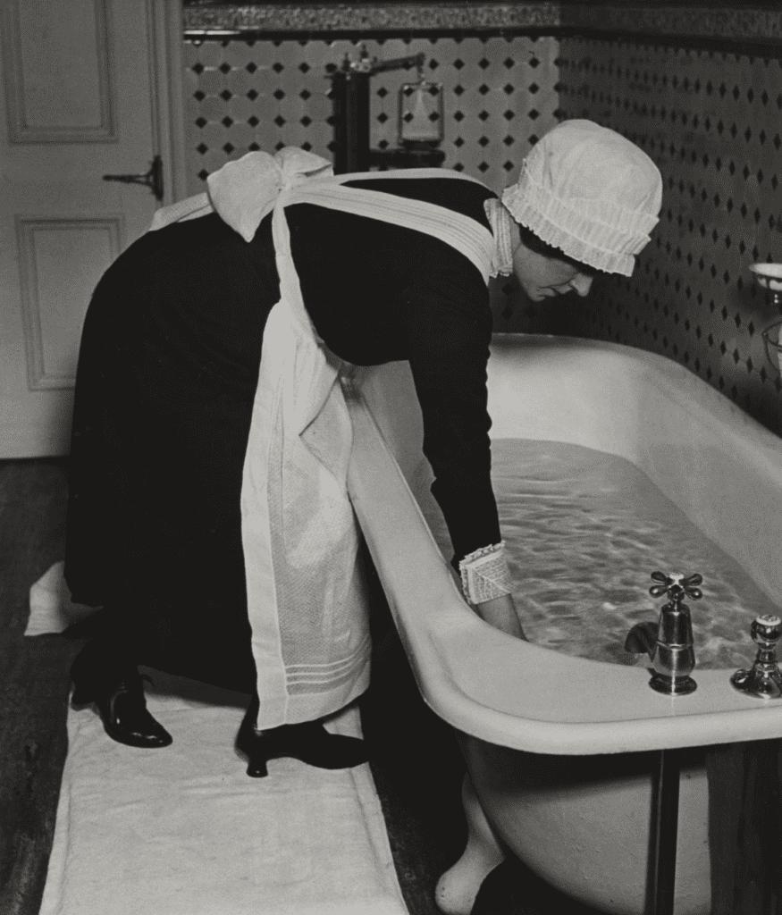 Bill Brandt, Parlourmaid Preparing a Bath before Dinner
