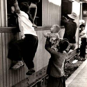Howard Sochurek, Refugees Scrambling Onto Train