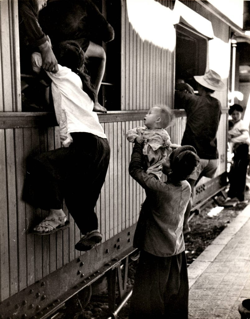 Howard Sochurek, Refugees Scrambling Onto Train