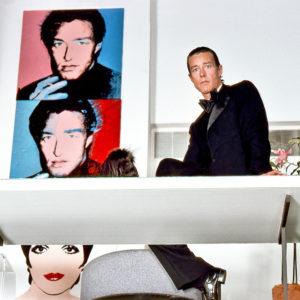 Harry Benson, Halston with Warhol painting, New York, 1978