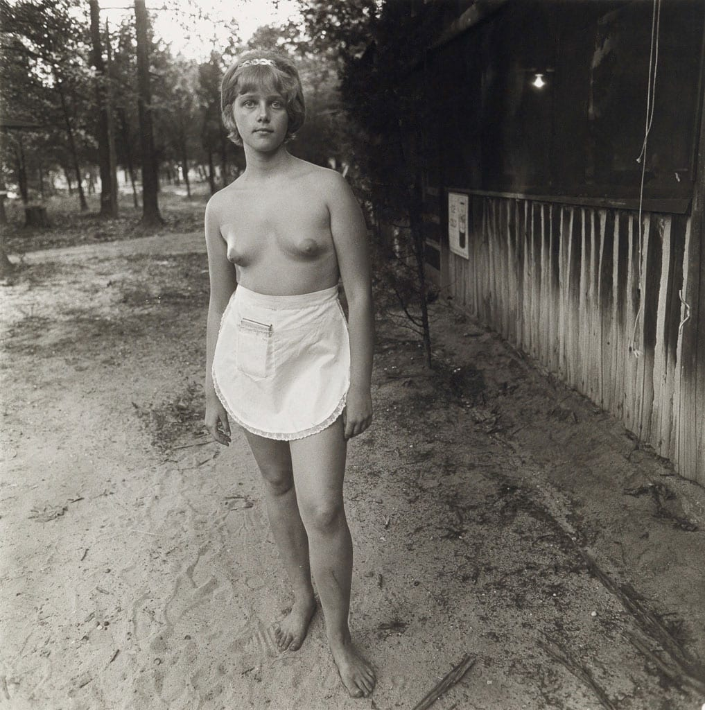 Diane Arbus, A Young Waitress at a Nudist Camp, NJ