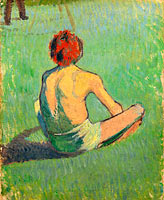 Boy sitting in the grass