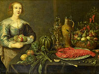 A young woman near a table with fruits