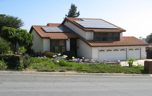 View of front of house, with solar electric panels