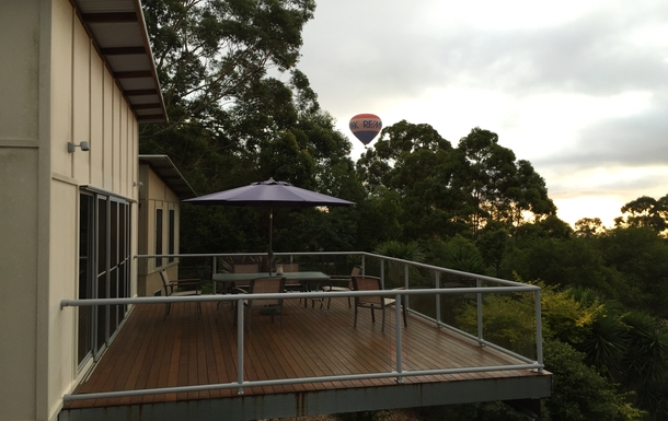 Home exchange in,Australia,Tamborine Mountain,Top deck with ballooners drifting by