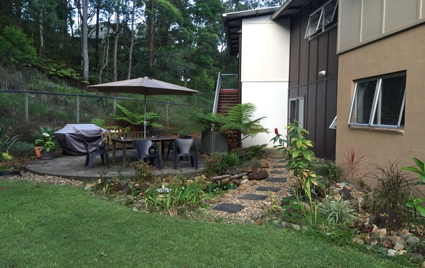Home exchange in,Australia,Tamborine Mountain,Rear garden with fish pond and BBQ
