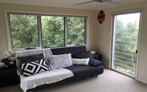 Home exchange in,Australia,Tamborine Mountain,Bedroom three couch folds into double bed.