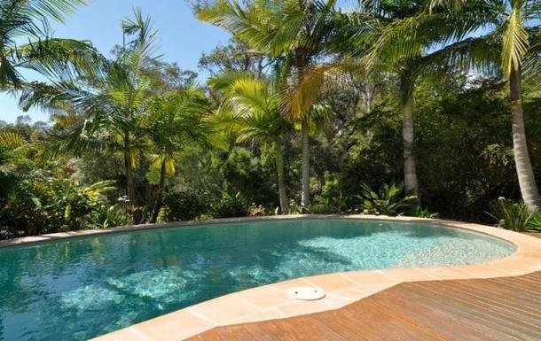 Home exchange in,Australia,TEWANTIN,The pool in it's tropical garden