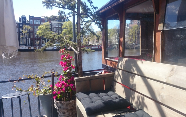 Outside deck view of Amsterdam canal houses