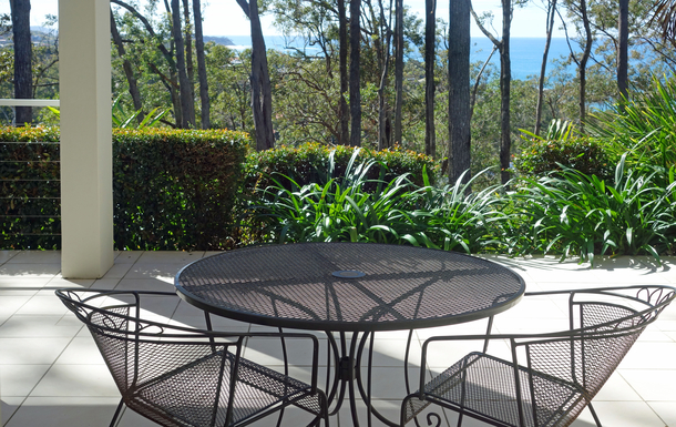 Home exchange in,Australia,COFFS HARBOUR,Patio with views through trees to the ocean