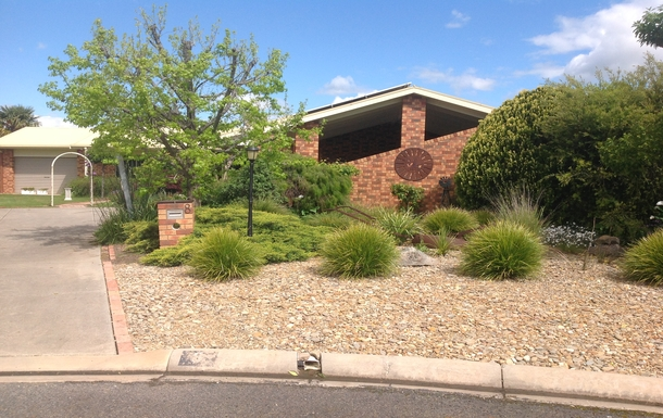 Home exchange in,Australia,BENALLA,Front of House showing Carport for 2 cars