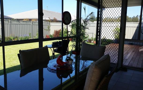 Home exchange in,Australia,FULLERTON COVE,outdoor living area opening onto deck