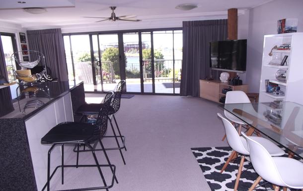 Home exchange in,Australia,Birtinya,Open plan living area with beautiful lake views