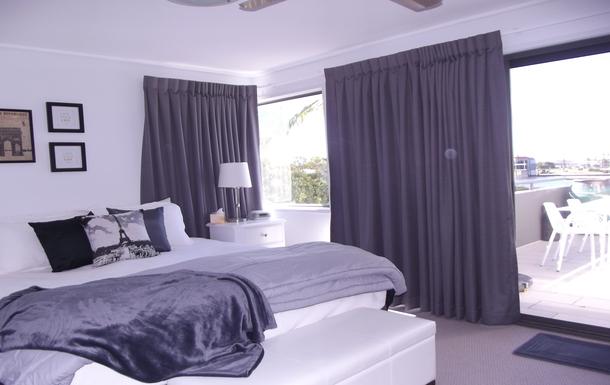 Home exchange in,Australia,Birtinya,Main Bedroom (King Bed) with views of Lake Kawana