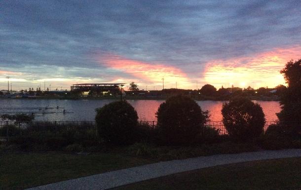 Home exchange in,Australia,Birtinya,Kayakers training on the lake at sunrise