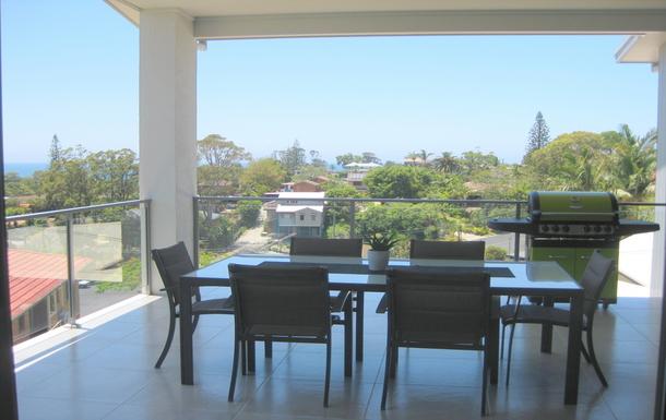 Home exchange in,Australia,Korora,Balcony perfect to catch the ocean breezes