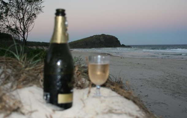 Home exchange in,Australia,POTTSVILLE,Drinks at sunset at our local beach.