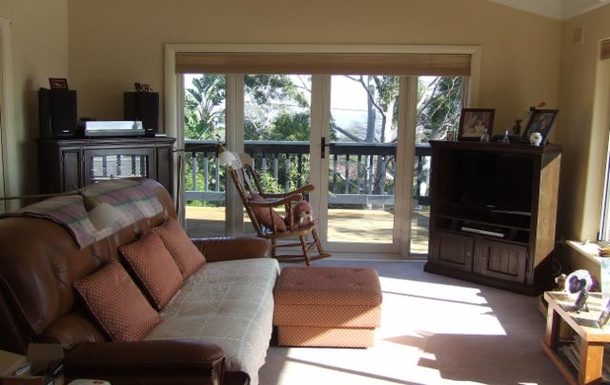 Home exchange in,Australia,LYNTON,Lounge room with French doors looking west