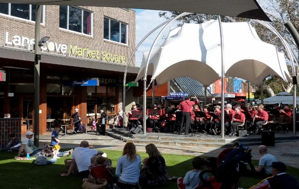 Home exchange in,Australia,LANE COVE,Plaza hosting a musical performance.