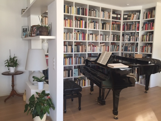 living room with gran piano