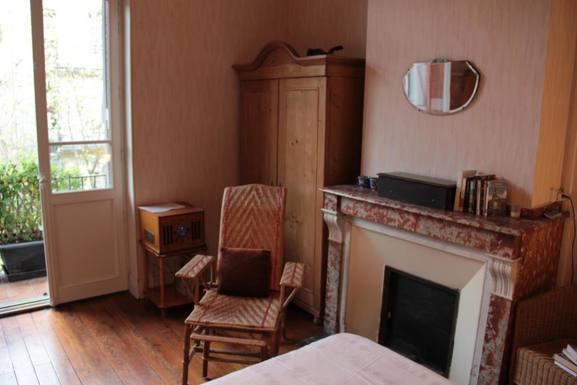 Bedroom gives onto rear balcony