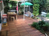 back deck with barBQ and dining