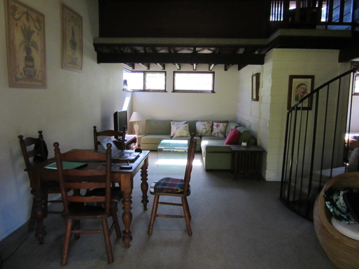 Home exchange in,Australia,CAIRNS,Lounge area downstairs. (Appears narrower than act
