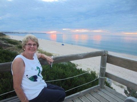 Home exchange in,Australia,CARRICKALINGA,Pat enjoying a sunset on the beach.