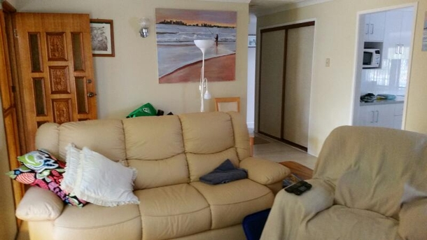 Home exchange in,Australia,Currumbin Waters, Gold Coast,Leather lounge seat and two leather recliners in t